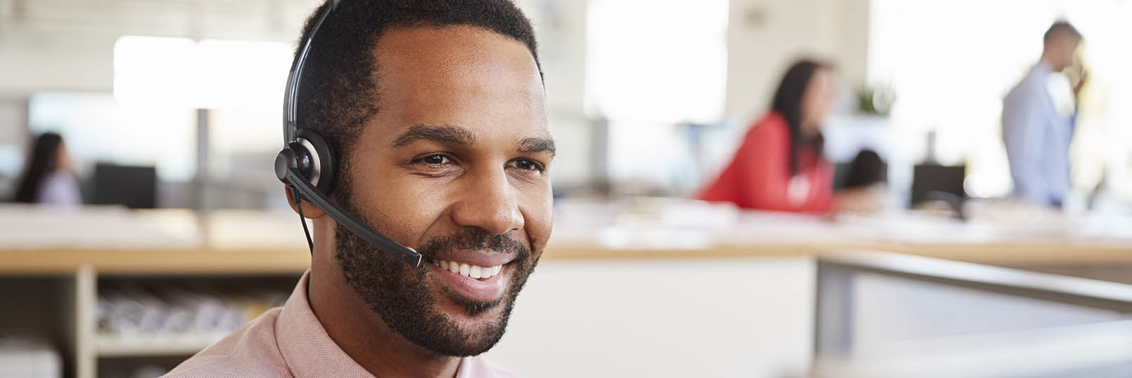 man in call center answering phone calls