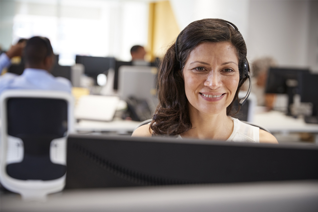 woman in a call center on a phone headset